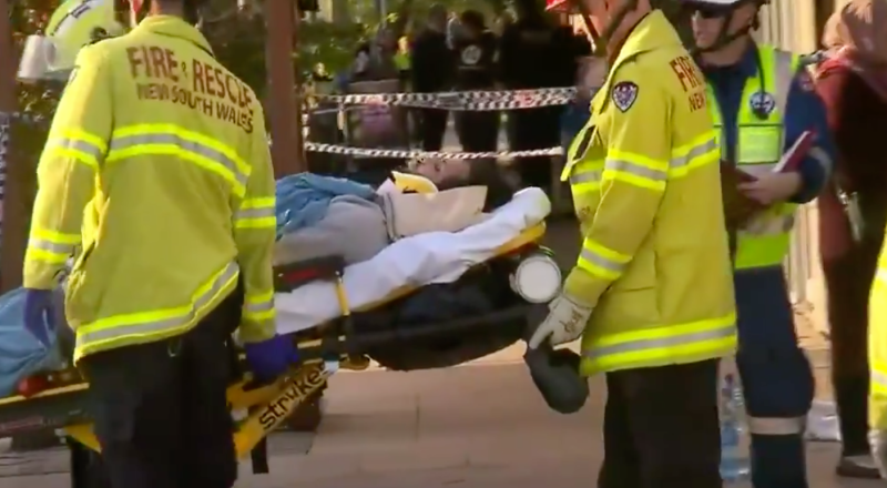 Paramedics shown tending to a victim in a stretcher. Source: Nine News