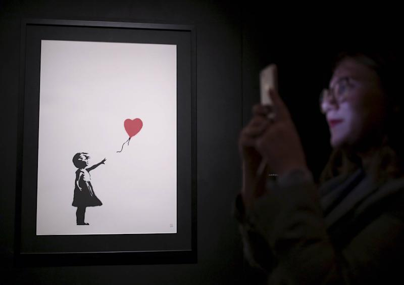 Banksy'Girl With Balloon Painting Worth Double After Self Destructing at AuctionMore