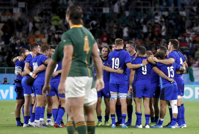Italy players embrace following their Rugby World Cup Pool B game at Shizuoka Stadium Ecopa against South Africa in Shizuoka, Japan, Friday, Oct. 4, 2019. South Africa defeated 49-3. (AP Photo/Shuji Kajiyama)