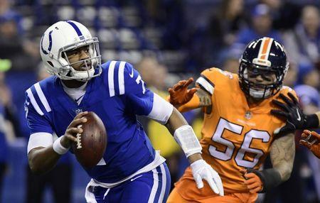 Dec 14, 2017; Indianapolis, IN, USA; Indianapolis Colts quarterback Jacoby Brissett (7) runs out of the pocket in the second quarter against the Denver broncos at Lucas Oil Stadium. Mandatory Credit: Thomas J. Russo-USA TODAY Sports