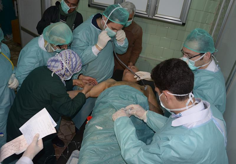 "In this photo released by the Syrian official news agency SANA, a Syrian victim who suffered an alleged chemical attack at Khan al-Assal village according to SANA, receives treatment by doctors, at a hospital in Aleppo, Syria, Tuesday March 19, 2013. Syria's information minister says a chemical weapon fired by rebels on a village in the north of the country is the ""first act"" by the opposition interim government announced in Istanbul. He says 16 people were killed and 86 wounded in the attack. Rebels have denied the accusation and say regime forces fired the weapon. (AP Photo/SANA)"