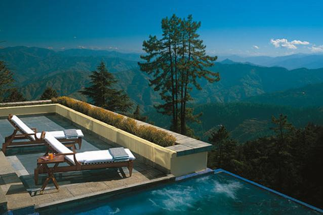 Wildflower Hall Himachal Pradesh - Wake up to the sweet smell of pine and cedar wafting through your suite, as the Himalayan monal chirps softly outside your window. Situated on a forested cliff, this refurbished colonial structure overlooks the snowcapped Pir Panjal range on one side and the mountains of Nanda Devi on the other. It's one of those entirely romantic spots you can't help falling for, where the suites come with four-poster beds, teakwood flooring and cosy fireplaces.