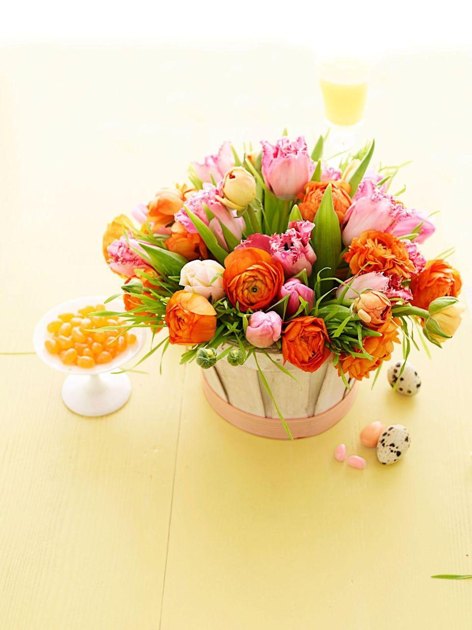 <p>Gather vivid flowers in similar tones in a ribbon-trimmed basket. Line with plastic wrap and pack with wet floral foam before adding stems and grass. </p>
