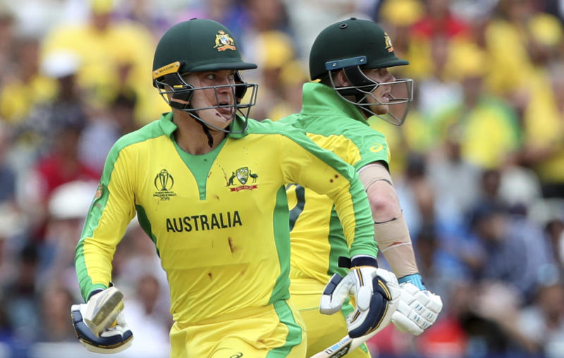 Australia's Alex Carey, left, and Steve Smith run between the wickets to score during the Cricket World Cup semi-final match between England and Australia at Edgbaston in Birmingham, England, Thursday, July 11, 2019. (AP Photo/Aijaz Rahi)