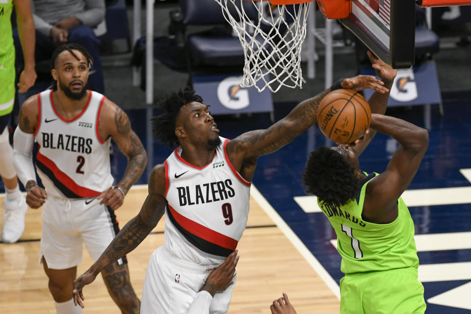 Portland Trail Blazers forward Nassir Little (9) blocks a shot by Minnesota Timberwolves guard Anthony Edwards (1) as Trail Blazers guard Gary Trent Jr.(2) watches during the first half of an NBA basketball game Saturday, March 13, 2021, in Minneapolis. (AP Photo/Craig Lassig)