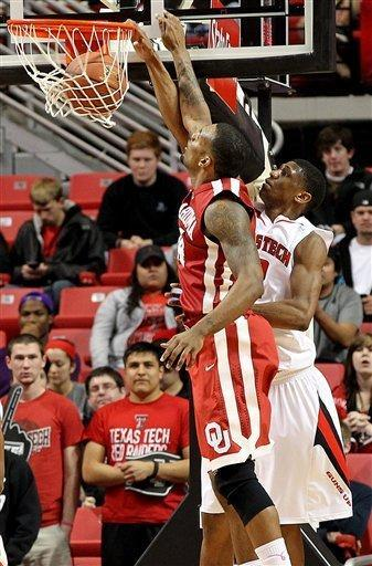 Texas Tech's Jordan Tolbert dunks against Oklahoma's Romero Osby during their NCAA college basketball game in Lubbock, Texas, Saturday, Feb. 11, 2012. (AP Photo/Lubbock Avalanche-Journal, Zach Long) ALL LOCAL TV OUT