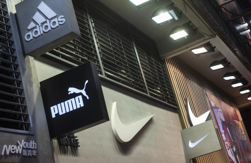 HONG KONG, CHINA - 2020/01/31: Multinational sport clothing brands Adidas, Puma and Nike logos seen at a store in Hong Kong. (Photo by Budrul Chukrut/SOPA Images/LightRocket via Getty Images)