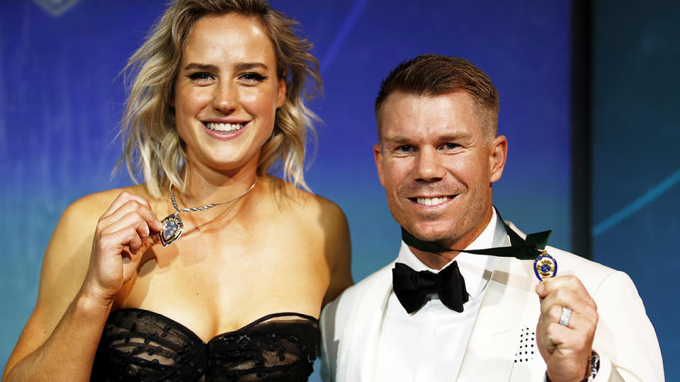 Ellyse Perry and David Warner, pictured here at the Australian Cricket Awards with their medals.