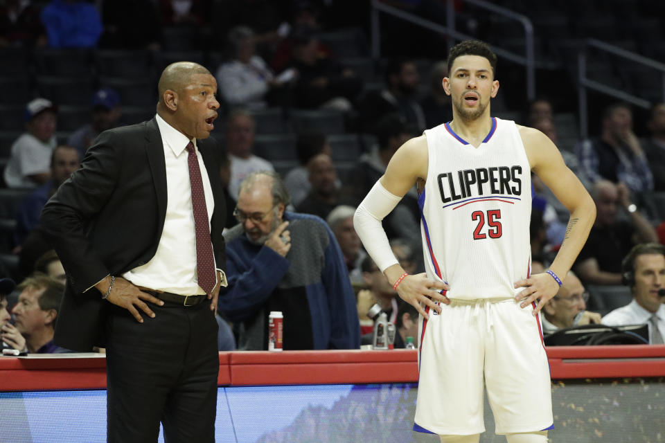 Los Angeles Clippers' Doc Rivers, left, talks to Austin Rivers during the second half of an NBA basketball game against the Indiana Pacers Sunday, Dec. 4, 2016, in Los Angeles. The Pacers won 111-102. (AP Photo/Jae C. Hong)