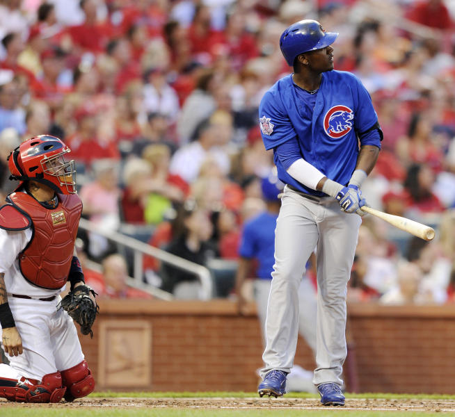 Chicago Cubs' Junior Lake, right, watches his three-run home run as St. Louis Cardinals' Yadier Molina, left, looks on in the second inning in a baseball game, Monday, May 12, 2014, at Busch Stadium in St. Louis. (AP Photo/Bill Boyce)