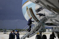 President Donald Trump boards Air Force One at Miami International Airport on Friday, July 10, 2020. (AP Photo/Evan Vucci)