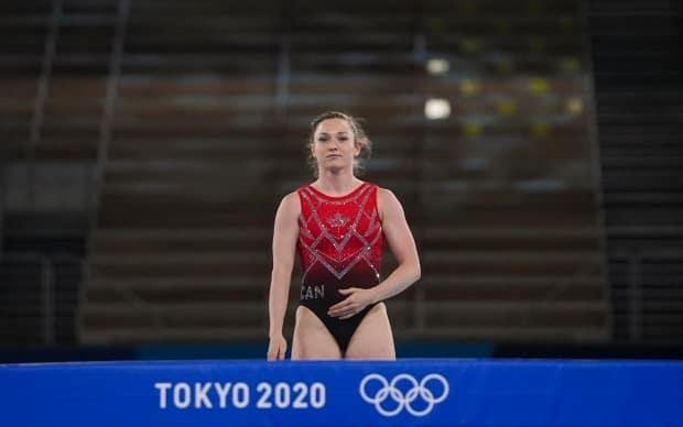 Canadian trampolinist Rosie MacLennan is seen competing in qualification heats during the Tokyo Games. (Leah Hennel/The Canadian Press - image credit)