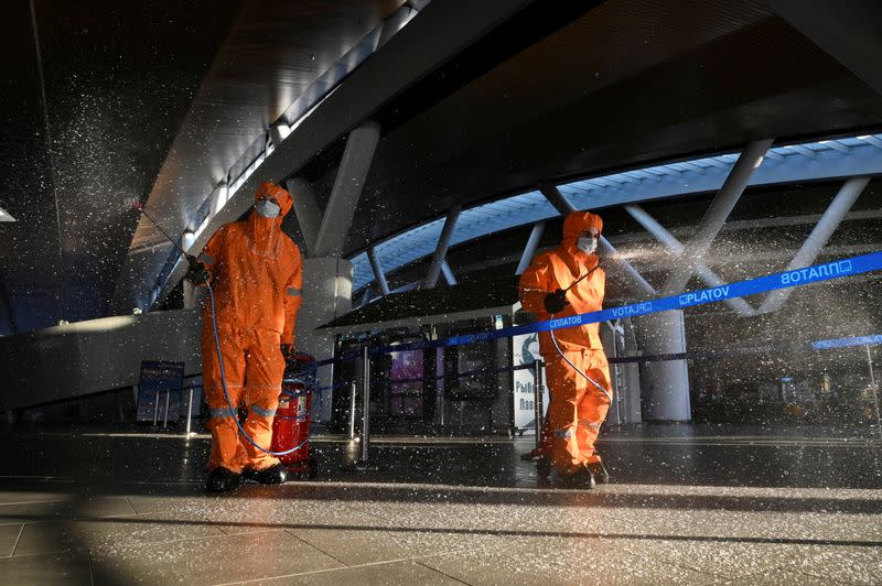 FILE PHOTO: Specialists sanitize an airport near Rostov-on-Don