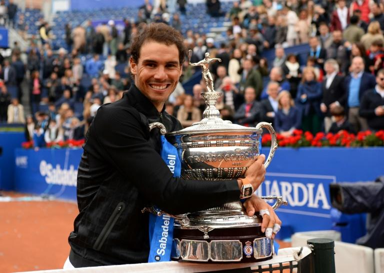 Spanish tennis player Rafael Nadal celebrates with his trophy after winning the ATP Barcelona Open