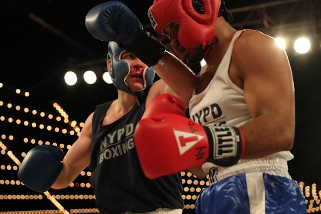 <p>Anthony Davilla (red) of the 79th Precinct in Brooklyn fights cadet Paul Altamore (blue) in the Brooklyn vs. Police Academy match during the NYPD Boxing Championships at the Hulu Theater at Madison Square Garden on March 15, 2018. (Gordon Donovan/Yahoo News) </p>