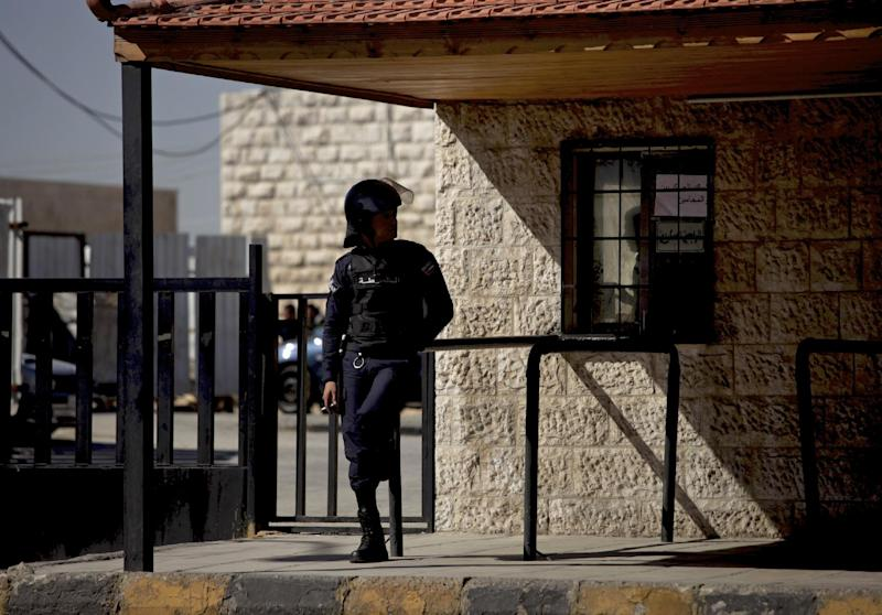 """A Jordanian policeman stands guard during the trial of radical Sunni preacher, Abu Qatada, in Amman, Jordan, Thursday, Feb. 13, 2014. The 52-year-old Abu Qatada told reporters during a break in his trial on Thursday that he """"supports"""" suicide attacks in Lebanon against Shiite targets. Abu Qatada has been described as a senior al-Qaida figure in Europe who had close ties to the late Osama bin Laden. (AP Photo/Mohammad Hannon)"""