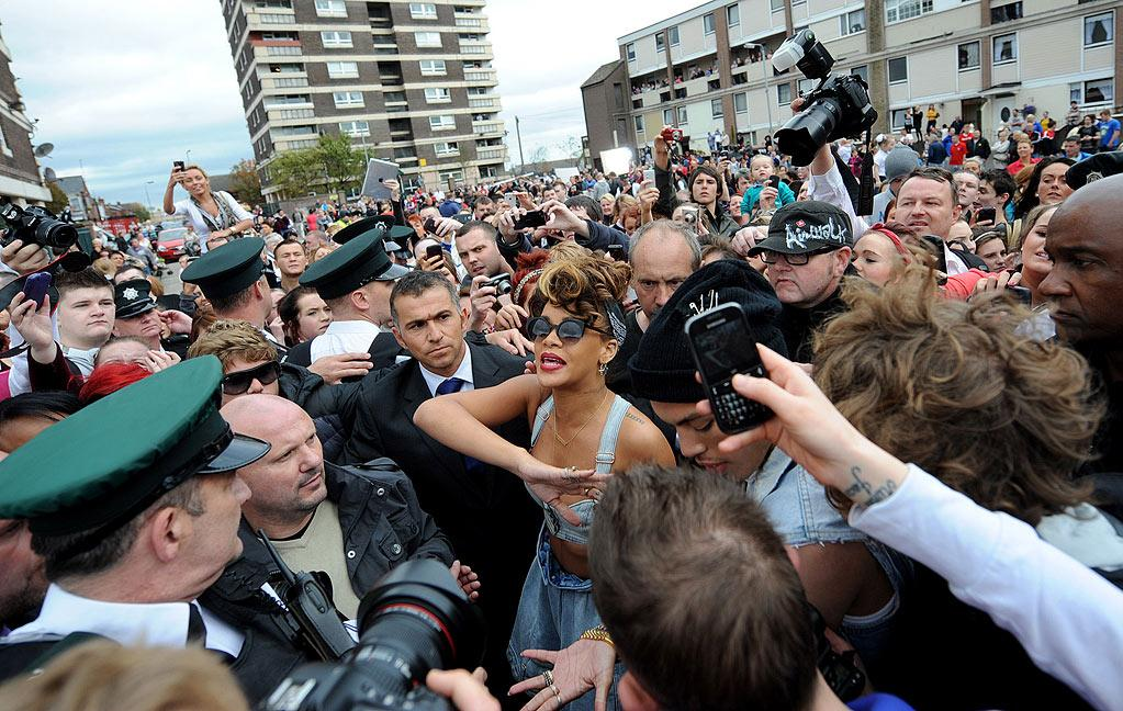 "Rihanna caused quite the stir in Northern Ireland this week. On Monday, a local farmer kicked Rihanna and crew off land where they were shooting a video for her song ""We Found Love"" for being too racy. The next day, she was mobbed by fans while shooting in Belfast. <a href=""http://www.infdaily.com"" target=""new"">INFDaily.com</a> - September 27, 2011"