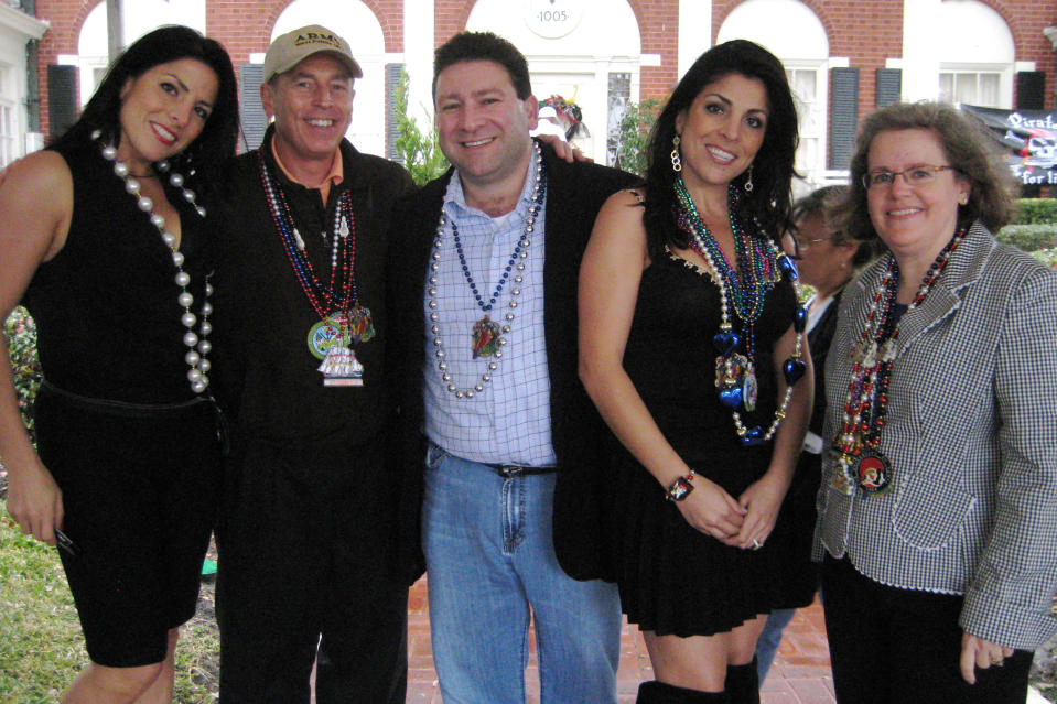 (L to R) Natalie Khawam, Gen. David Petraeus, Dr. Scott Kelley, Jill Kelley and Holly Petraeus, attend the Gasparilla parade on Jan. 30. 2010, in Tampa, Fla. Jill Kelley was identified as the woman who received threatening emails from the biographer of Gen. David Petraeus, Paula Broadwell, with whom he allegedly had an affair. (AP Photo/The Tampa Bay Times, Amu Scherzer)