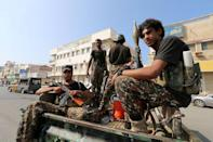FILE PHOTO: Houthi militants patrol a street where pro-Houthi protesters demonstrated against the Saudi-led coalition in Hodeidah, Yemen December 10, 2018. Picture taken December 10, 2018. REUTERS/Abduljabbar Zeyad/File Photo