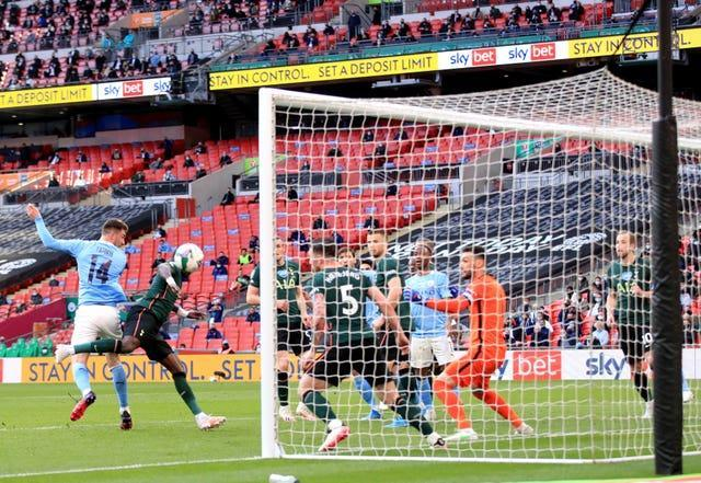 Aymeric Laporte, left, scores Manchester City's winner at Wembley on Sunday