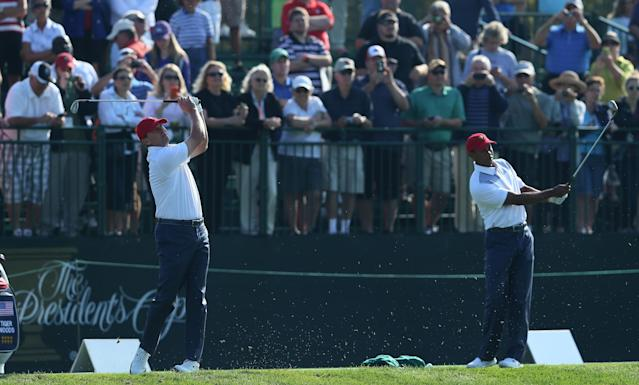 DUBLIN, OH - OCTOBER 01: Steve Stricker (L) and Tiger Woods of the U.S. Team hits shots on the practice ground prior to the start of The Presidents Cup at the Muirfield Village Golf Club on October 1, 2013 in Dublin, Ohio. (Photo by Andy Lyons/Getty Images)