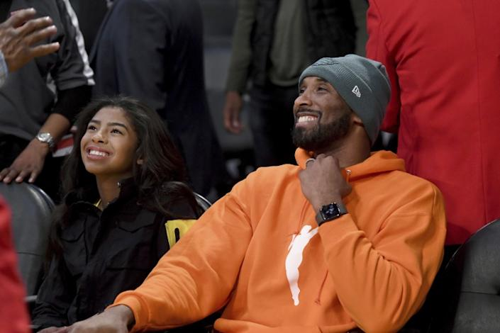 "Kobe Bryant and his daughter Gianna attend a game between the Lakers and Dallas Mavericks on Dec. 29, 2019 at Staples Center. <span class=""copyright"">(Michael Owen Baker / Associated Press)</span>"