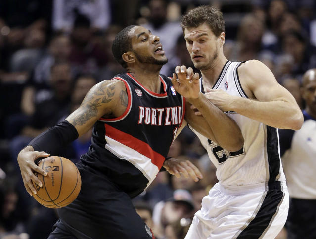Portland Trail Blazers' LaMarcus Aldridge, left, is pressured by San Antonio Spurs' Tiago Splitter, of Brazil, during the first half of Game 1 of a Western Conference semifinal NBA basketball playoff series, Tuesday, May 6, 2014, in San Antonio. (AP Photo/Eric Gay)
