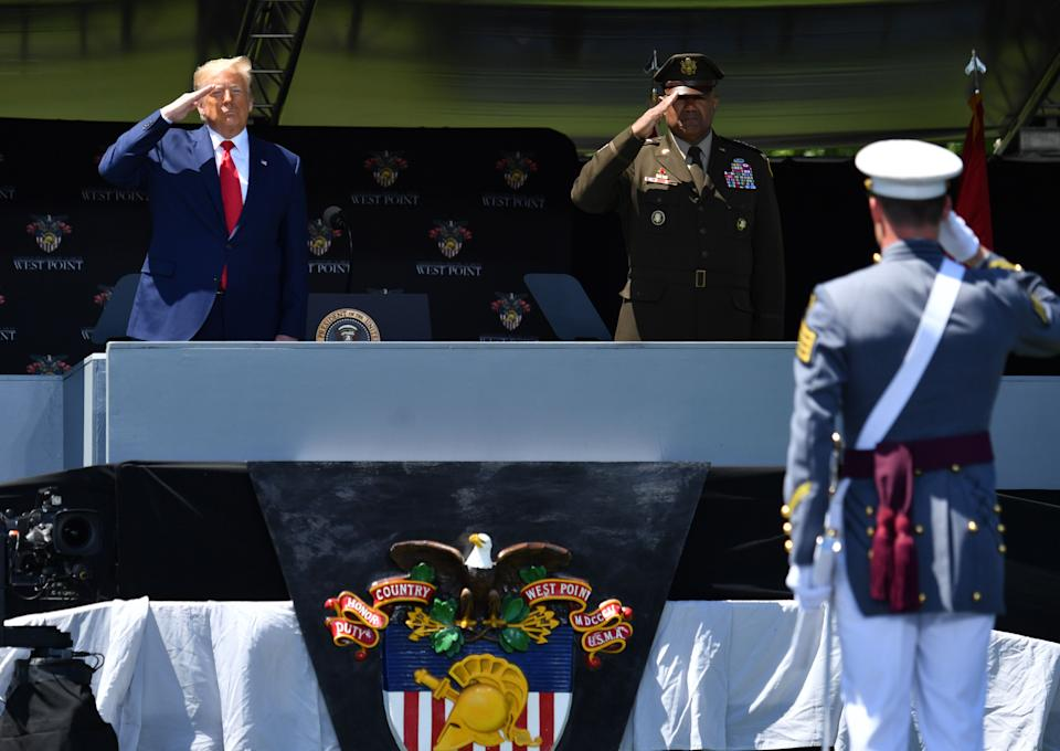 US President Donald Trump and Military Academy Superintendent Darryl Williams (R) salute cadets at the 2020 US Military Academy  graduation ceremony in West Point, New York, June 13, 2020. - Trump delivered the commencement address at the ceremony. (Photo by Nicholas Kamm / AFP) (Photo by NICHOLAS KAMM/AFP via Getty Images)