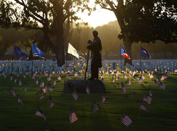 <p>The statue of a Civil War soldier stands amid flags placed by volunteer groups at the Los Angeles National Military Cemetery two days before Memorial Day in Los Angeles, Calif., on May 26, 2018. (Photo: Mark Ralston/AFP/Getty Images) </p>