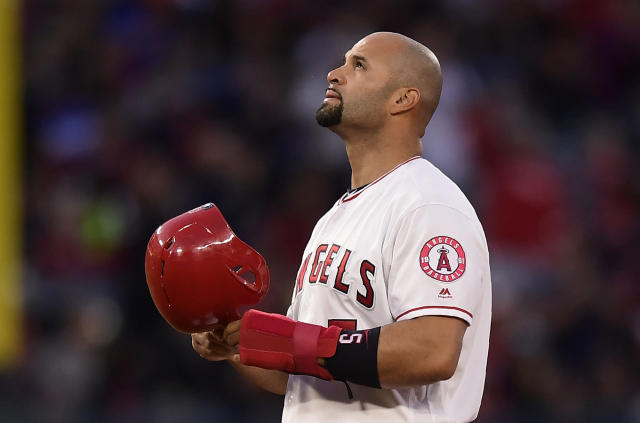 Los Angeles Angels' Albert Pujols looks toward the sky after hitting an RBI double during the third inning of a baseball game against the Seattle Mariners Saturday, April 20, 2019, in Anaheim, Calif. With that RBI, Pujols tied Babe Ruth for 5th place on the all-time RBI list with 1,992. (AP Photo/Mark J. Terrill)