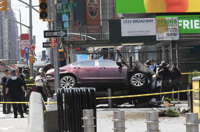 <p>A car rests on a security barrier in New York's Times Square after driving through a crowd of pedestrians, injuring at least a dozen people, Thursday, May 18, 2017. (AP Photo/Mary Altaffer) </p>