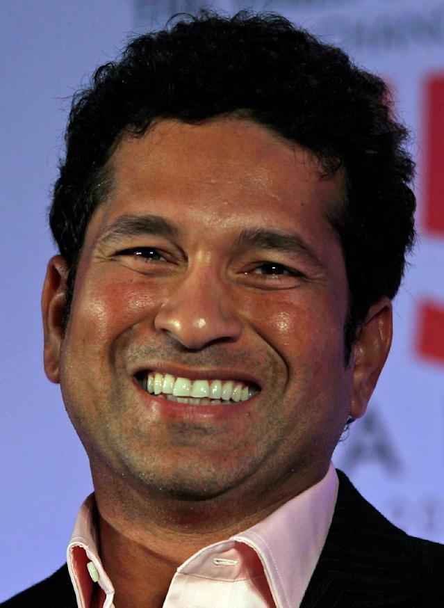 FILE - In this Tuesday, May 28, 2013 file photo, Indian cricketer Sachin Tendulkar smiles during a book release function in Mumbai, India. Tendulkar said he will retire from test cricket after his 200th test. (AP Photo/Rajanish Kakade, File)