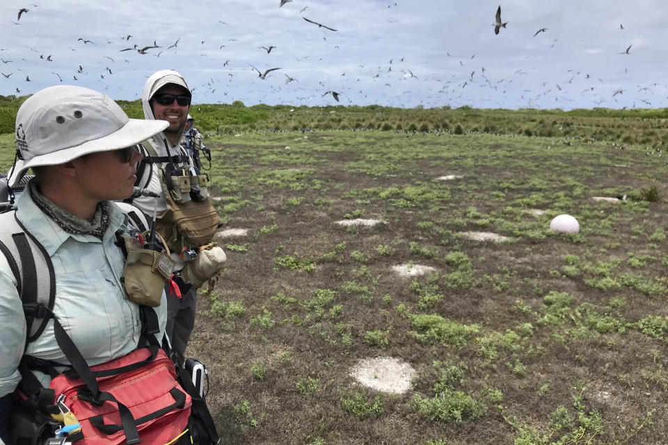 In this March 12, 2020 photo provided by Matt Saunter, Matt Butschek II, right, and Charlie Thomas, prepare for field work at Kure Atoll in the Northwestern Hawaiian Islands, one of the most remote places on Earth. Cut off from the rest of the planet since February, they are back, re-emerging into a society changed by the coronavirus outbreak. (Matt Saunter/Hawaii Department of Land and Natural Resources via AP)