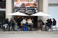 Cafe life returns to Milan's streets