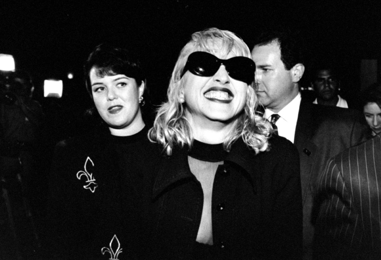 Actress Rosie O'Donnell (L) looking askance at singer/actress Madonna who is giving a grimacing smile amongst others at premiere party for the movie A League of Their Own at Tavern on the Green restaurant.  (Photo by Robin Platzer/Twin Images/The LIFE Images Collection via Getty Images/Getty Images)