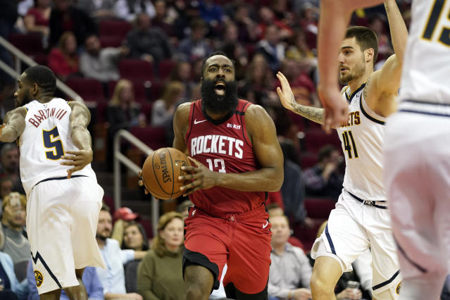 Houston Rockets' James Harden (13) reacts after being fouled by Denver Nuggets' Will Barton (5) during the second half of an NBA basketball game Wednesday, Jan. 22, 2020, in Houston. The Rockets won 121-105. (AP Photo/David J. Phillip)