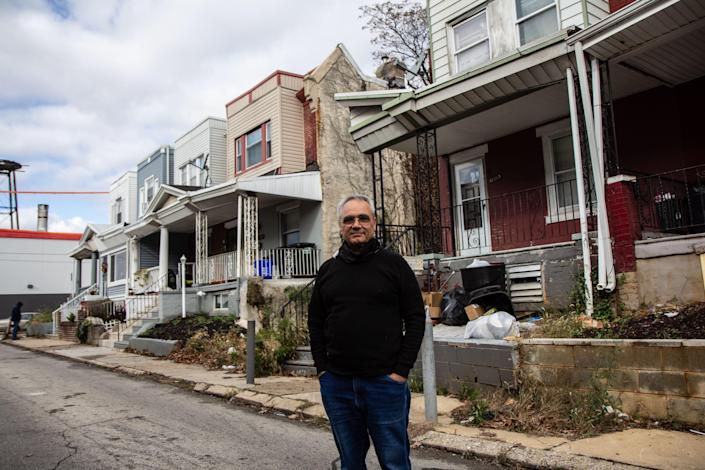 """Moshe Attas in front of his property on Airdrie Street in Philadelphia. After getting involved in the city's landmark eviction diversion program, Attas said he thinks """"this system should replace the tenant-landlord court."""""""