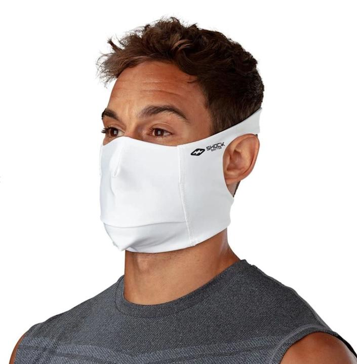 "This athletic face mask has a lightweight design that wraps around the back of your head to it won't slip during burpees, jumps or long runs. It's also easier on the ears. Plus, it features an easy-access flap for staying hydrated,. <a href=""https://fave.co/3fv5Kwy"" rel=""nofollow noopener"" target=""_blank"" data-ylk=""slk:Find it for $20 at Shock Doctor"" class=""link rapid-noclick-resp"">Find it for $20 at Shock Doctor</a>."
