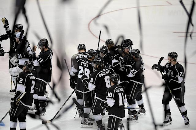 Members of the Los Angeles Kings celebrate Justin Williams's goal in overtime of Game 1 in the NHL Stanley Cup Final hockey series against the New York Rangers on Wednesday, June 4, 2014, in Los Angeles. (AP Photo/Mark J. Terrill)