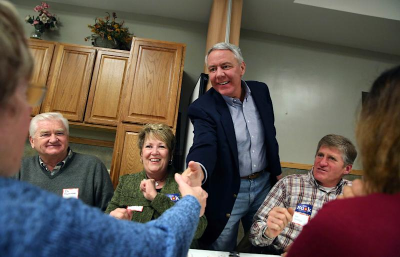 In this Jan. 24, 2014 photo, Weld County District Attorney Ken Buck, seen as the front-runner in the GOP primary for the upcoming U.S. Senate race, shakes hands with supporter Arlene Burnham during a campaign dinner event at Johnson's Corner, a truck stop and diner in Johnstown, Colo. Buck narrowly lost a 2010 Senate bid after being hammered for statements that angered some women and gays. Now his candidacy will be a test of whether a tea party favorite can do better in 2014. (AP Photo/Brennan Linsley)