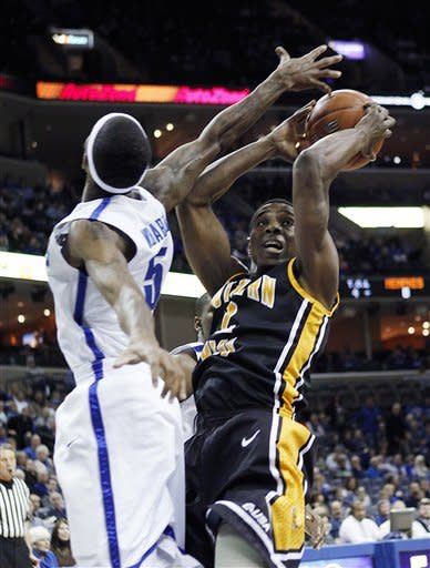 Southern Mississippi guard Rashard McGill, right, goes to the basket against Memphis guard Will Barton (5) in the first half of an NCAA college basketball game Wednesday, Jan. 11, 2012, in Memphis, Tenn. (AP Photo/Lance Murphey)