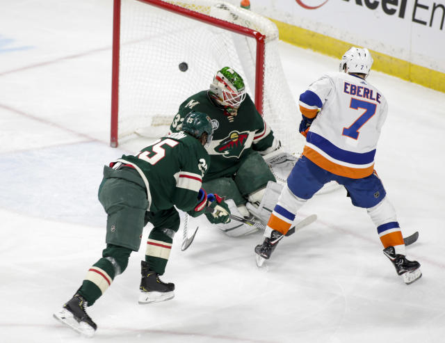 New York Islanders right wing Jordan Eberle (7) scores on Minnesota Wild goaltender Alex Stalock (32) as defenseman Jonas Brodin (25) defends on the play during the first period of an NHL hockey game Sunday, March 17, 2019, in St. Paul, Minn. (AP Photo/Paul Battaglia)