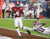 Alabama wide receiver Jerry Jeudy (4) scores a touchdown ahead of a takle by Oklahoma cornerback Parnell Motley (11), during the second half of the Orange Bowl NCAA college football game, Saturday, Dec. 29, 2018, in Miami Gardens, Fla. (AP Photo/Wilfredo Lee)