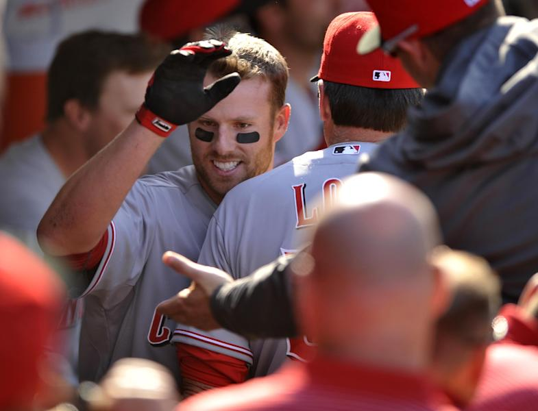 Cincinnati Reds' Zack Cozart celebrates with teammates in the dugout after hitting a two-run home run during the seventh inning of a baseball game against the Chicago Cubs in Chicago, Saturday, April 20, 2014. (AP Photo/Paul Beaty)