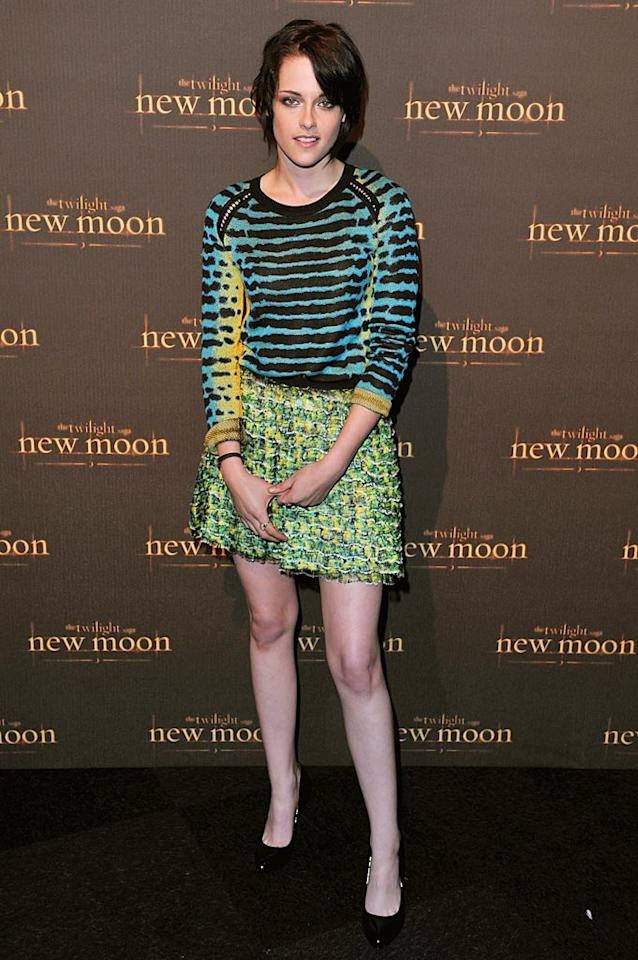 """When will Kristen Stewart buy a mirror and learn to pose? At the """"Twilight Saga: New Moon"""" fan event in London, the woman best known as Bella Swan once again slouched her way down the arrivals line in an atrocious ensemble. Hopefully, she'll get her act together before the LA premiere next week! Jon Furniss/<a href=""""http://www.wireimage.com"""" target=""""new"""">WireImage.com</a> - November 11, 2009"""