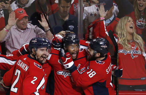 "<a class=""link rapid-noclick-resp"" href=""/nhl/teams/was"" data-ylk=""slk:Capitals"">Capitals</a> fans on their way watch Game 3 of the Stanley Cup Final had a close encounter with two of the team's players. (AP)"