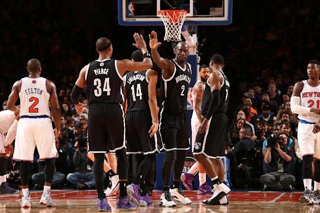 NEW YORK, NY - JANUARY 20: Paul Pierce #34 of the Brooklyn Nets high-fives teammate Kevin Garnett #2 during a game against the New York Knicks at Madison Square Garden in New York City on January 20, 2014. (Photo by Nathaniel S. Butler/NBAE via Getty Images)
