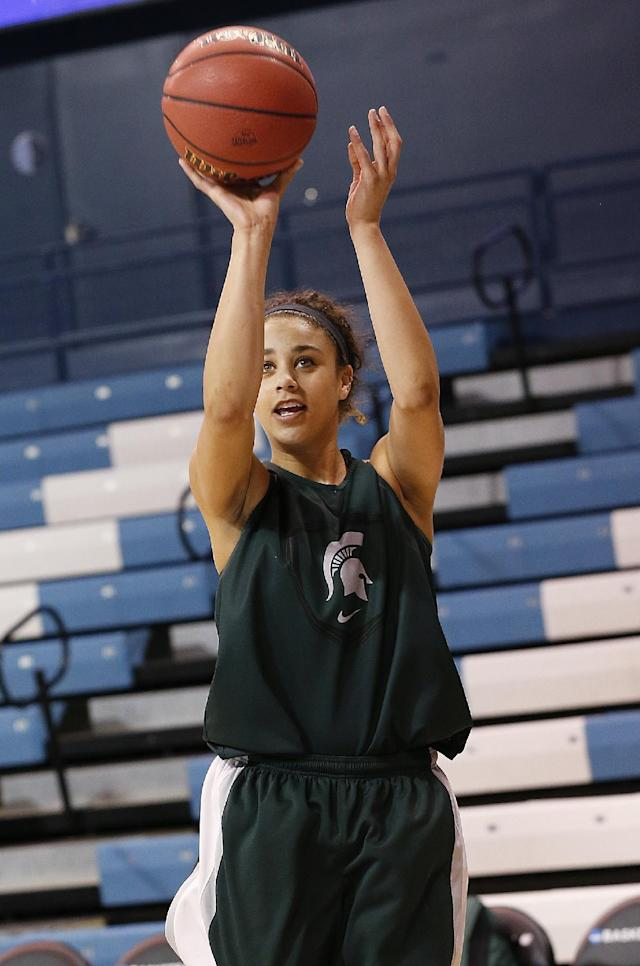 Michigan State's Klarissa Bell shoots during practice at the NCAA women's college basketball tournament in Chapel Hill, N.C., March 22, 2014. Michigan State plays Hampton in a first-round game on Sunday. (AP Photo/Ellen Ozier)