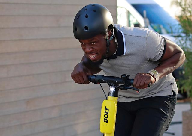 Former sprinter Usain Bolt rides an electric scooter during the international launching of Bolt Electric Scooters by Bolt Mobility in Paris, France May 15, 2019. REUTERS/Gonzalo Fuentes