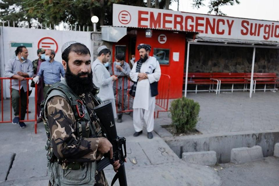 Taliban guard a hospital in Kabul after several civilians were killed in an explosion (Reuters)